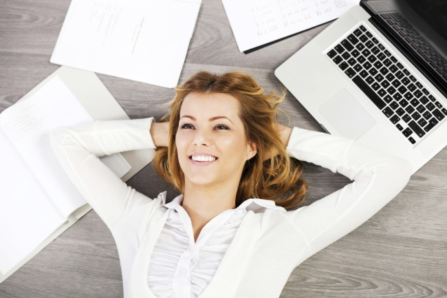 Young business woman relaxing on a floor. [url=http://www.istockphoto.com/search/lightbox/9786622][img]http://dl.dropbox.com/u/40117171/business.jpg[/img][/url]